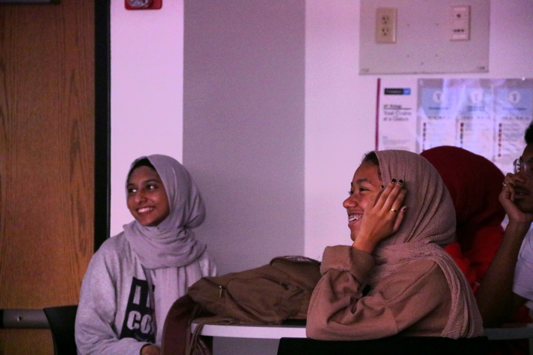 Coppell High School juniors Hidayah Husain and Sheikha Seif watch the 2019 Muslim Interscholastic Tournament (MIST) recap video during the first Muslim Student Association (MSA) club meeting of the school year on Oct. 15. This meeting helps club members understand the importance of the MSA. Photo by Tracy Tran.