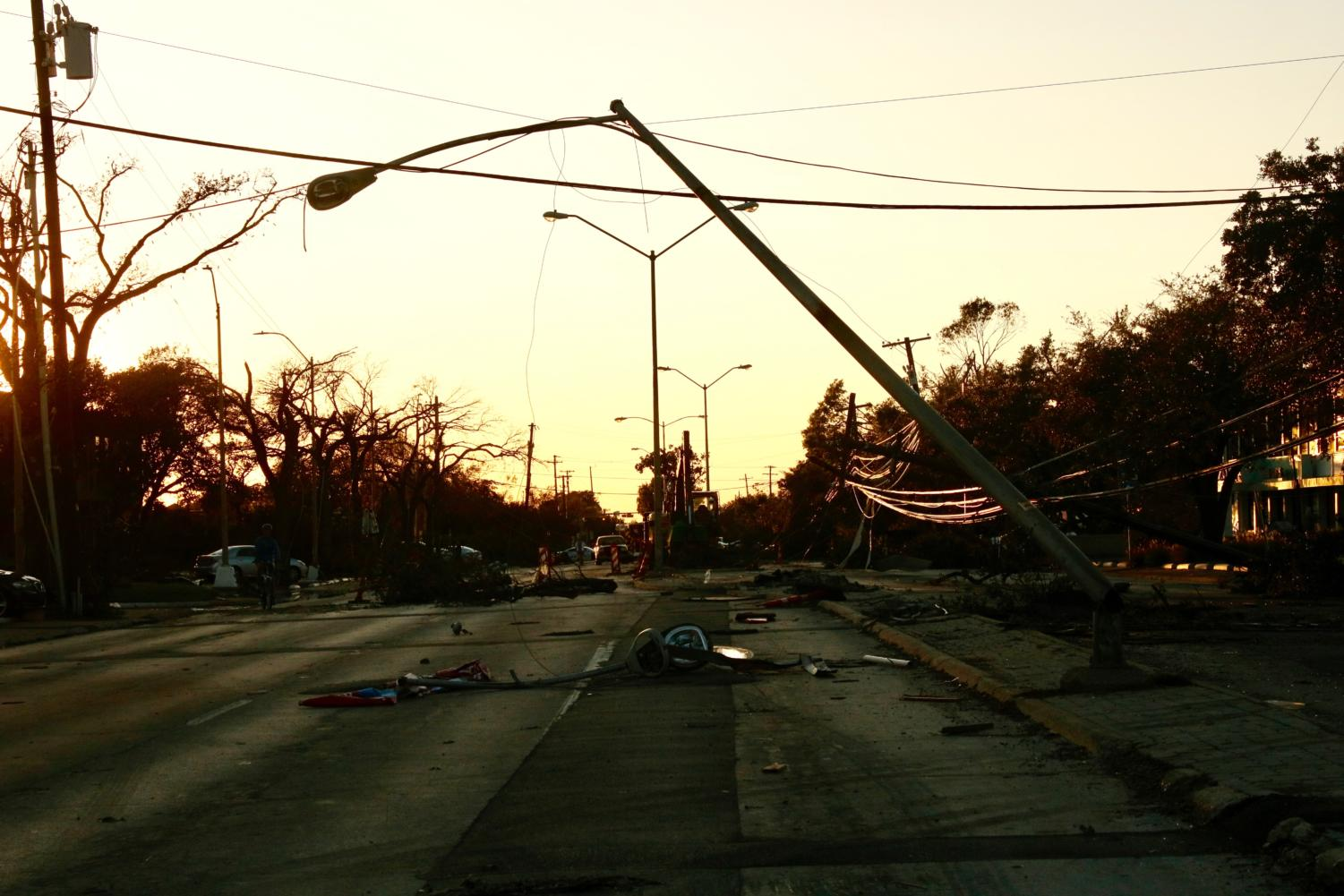 Scattered debris from street lights and trees lie on Royal Lane in Dallas on Monday. Nine tornadoes hit North Dallas Sunday night and devastated many businesses, residential areas and schools.