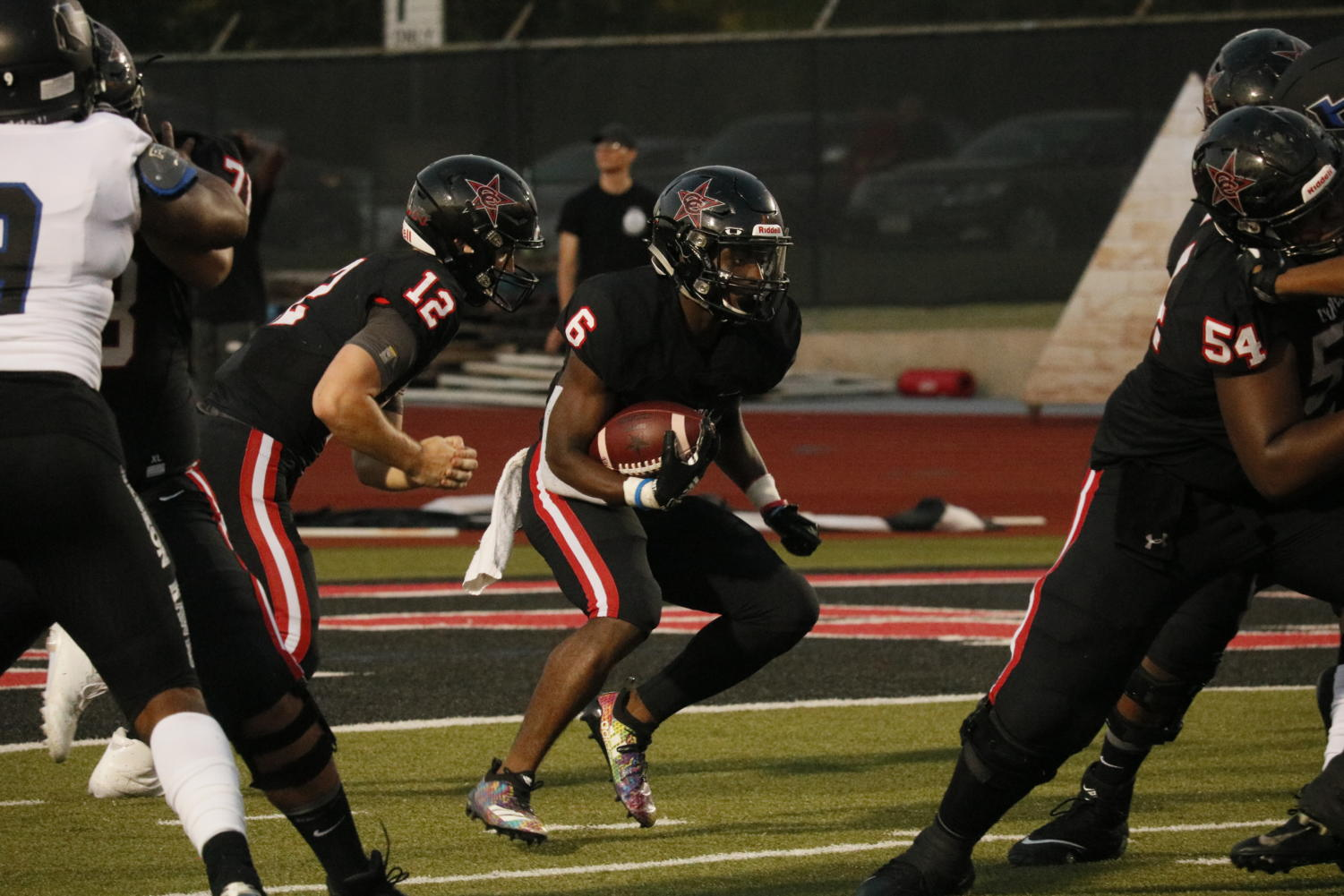 Coppell junior running back Jason Ngwu looks for a gap in the Hebron defense on Friday night at Buddy Echols Field. The Cowboys take on Lewisville tomorrow at 7 p.m. at Buddy Echols Field.
