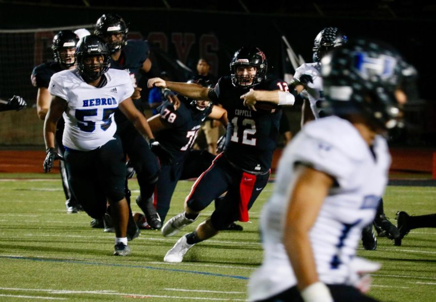 Hawks fly ahead of Cowboys in first home district game