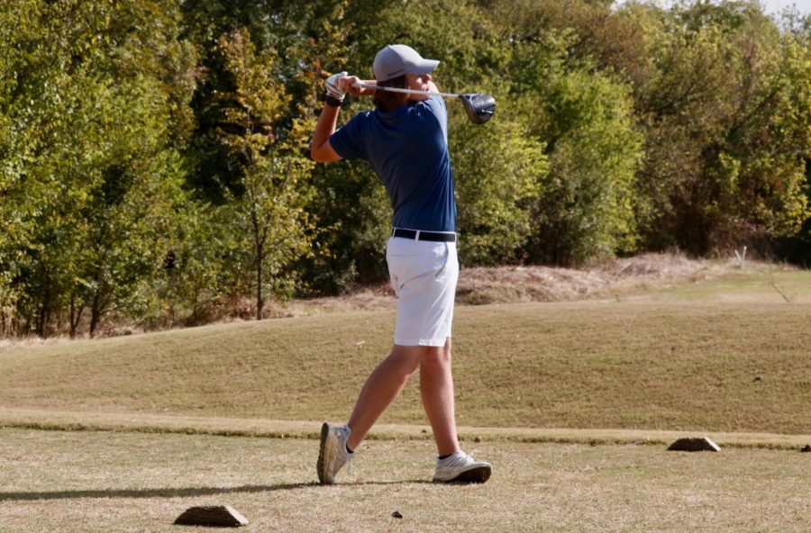 Coppell senior golfer Jackson Newsum watches as his drive travels down the fairway on Oct. 16 at Riverchase Golf Course. He has played golf since age of 2 and intends to continue working in golf as a career.