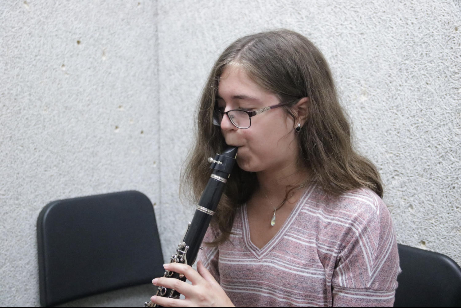 Coppell High School senior Emilie Sangerhausen practices her clarinet on Oct. 15 before school in the CHS band hall. Sangerhausen has played clarinet for seven years. Photo by Tracy Tran