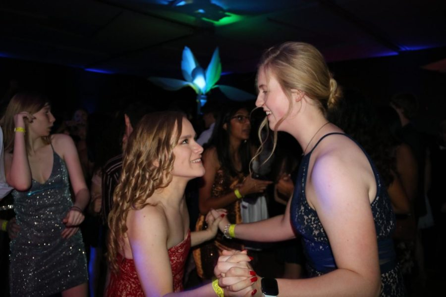 Coppell+High+School+sophomore+Shelby+Magruder+and+junior+Emily+Broome+dance+together+at+CHS+homecoming+dance+on+Saturday+night+at+Irving+Convention+Center.+The+Coppell+High+School+homecoming+dance+is+held+annually+during+homecoming+week%2C+with+various+CHS+traditional+activities.
