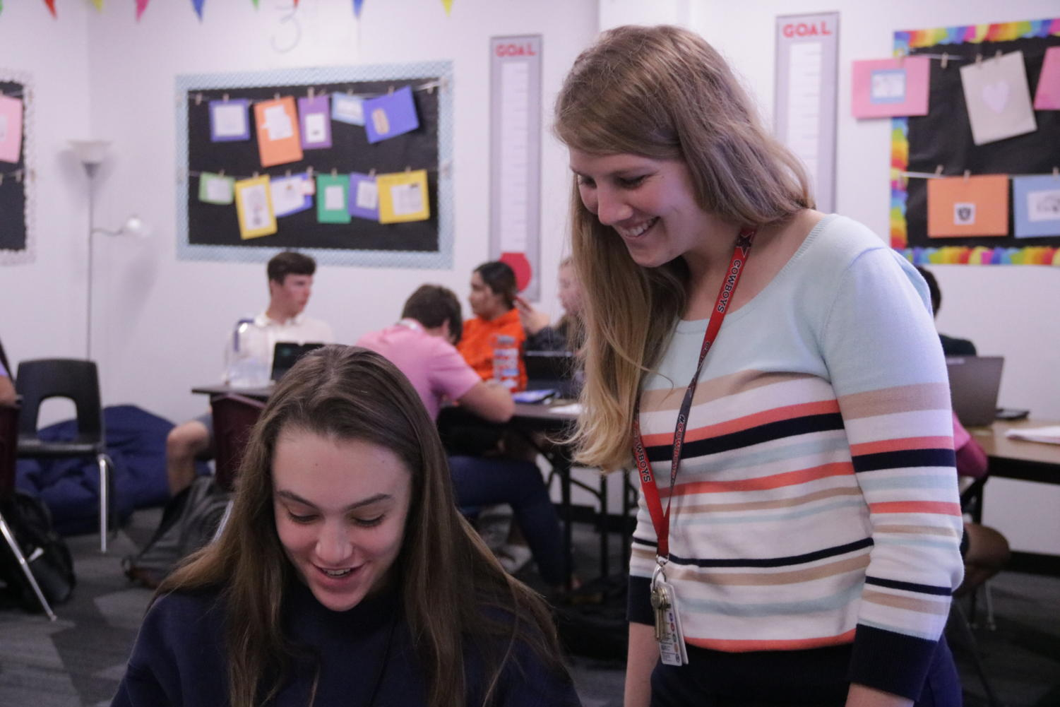 Coppell High School Money Matters teacher Megan Mackin helps sophomore Emma Harper with her budgeting project during sixth period on Thursday. Students in Mackin's class learn the importance of managing money. Photo by Camila Flores.