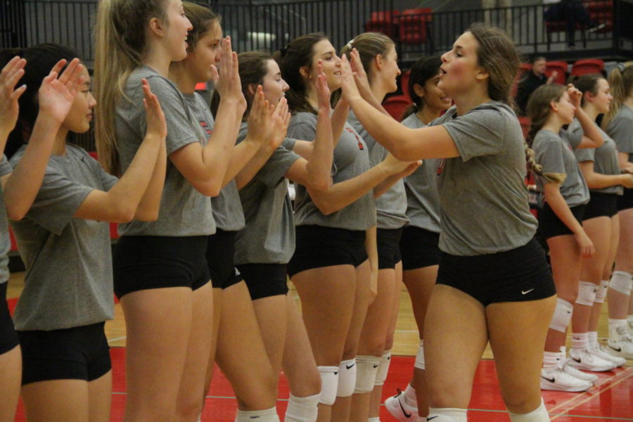 Coppell+senior+setter+Kinsey+Bailey+greets+her+teammates+during+pregame+introductions++in+the+Coppell+High+School+Arena+on+Friday.+Coppell+defeated+Lewisville%2C+3-0.+