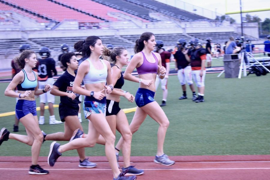 Coppell+cross+country+runners+junior+Morgan+Colon%2C+junior+Natalie+Fleming%2C+freshman+Waverly+Hassman%2C+senior+Shelby+Spoor%2C+and+junior+Chloe+Hassman+run+on+the+Buddy+Echols+Field+Track+before+school+on+Oct.+15.+Waverly+has+grown+up+in+a+family+of+runners.