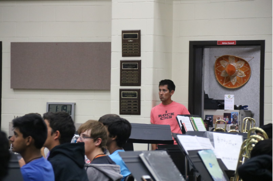 Coppell High School associate director of bands Adrian Caswell actively listens to head band director Gerry Miller as he discusses their trip to St. Louis at the CHS Band Hall on Wednesday. The CHS Marching Band will perform at Bands of America Super Regional in St. Louis on Oct. 19.