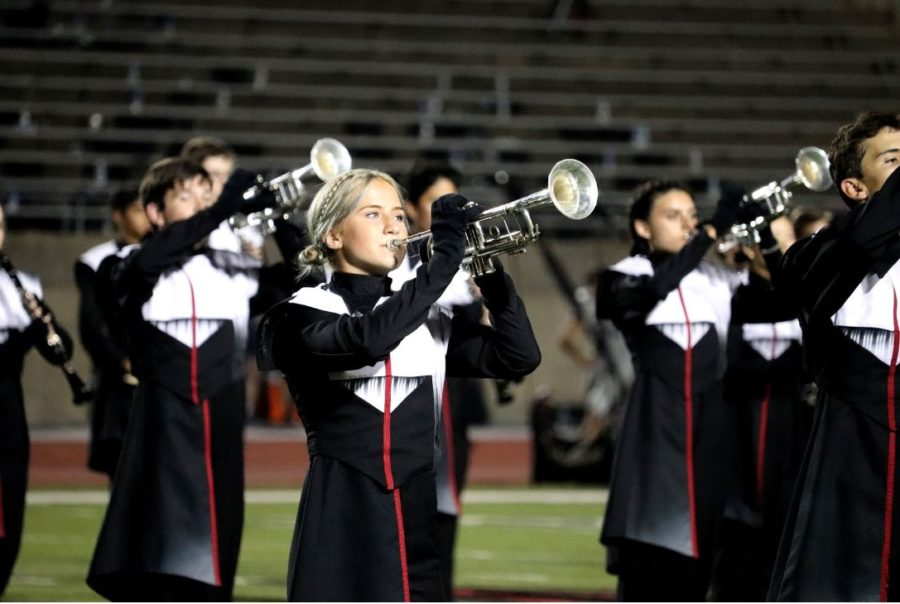 Coppell High School Band members perform at the first home football game of the season against L.D. Bell on Sept. 6. The CHS Band placed sixth at the Bands of America Super-Regional competition in St. Louis on Oct. 18-19. Photo by Samantha Freeman.