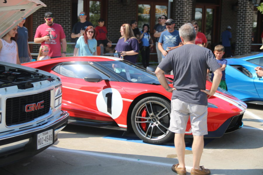 Crowd gathers around popular 2006 Ford GT on Sunday at the Coppell Car Show at Coppell Old Town Pavilion. The Coppell Car Show features many types of cars from the 70's to the 2000's.