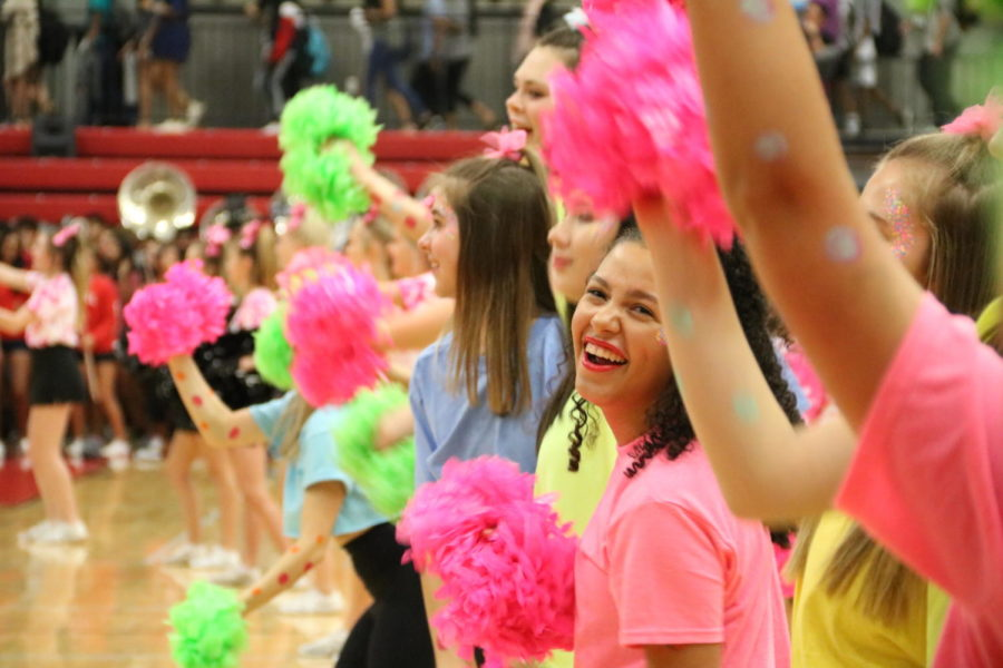 "Coppell High School Lariettes dance to the rhythm of the band at the start of the pep rally in the CHS Arena on Friday. The pep rally was the second of the year, which included a performance by senior Langston Gardner singing""Shoreside"" from his album Mystic Trail."
