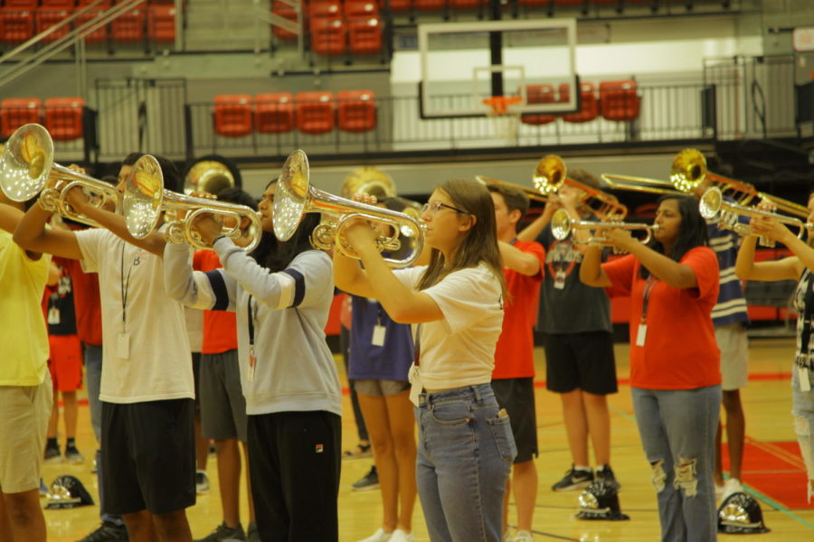 Coppell+High+School+sophomore+Carolyn+Bittner+plays+the+mellophone+before+the+pep+rally+on+Friday+at+the+CHS+Arena.+The+CHS+band+performs+at+every+pep+rally.
