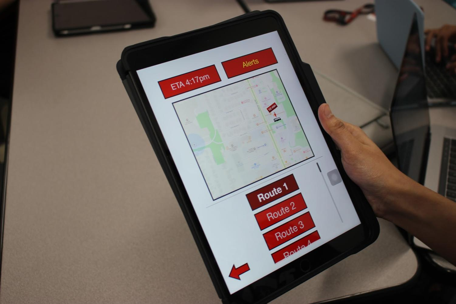 Coppell High School senior Ridha Syed shows her iPad app prototype in her eighth period Practicum and STEM class. Syed made a prototype that tracks bus routes, indicates when a bus is late and sends alerts to the user.