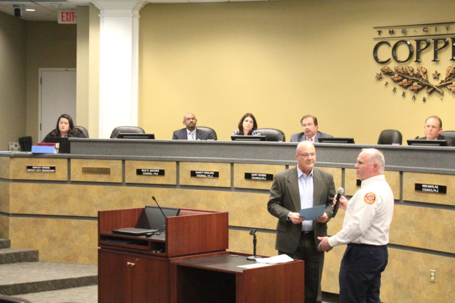 During Tuesday's Coppell City Council meeting at Coppell City Hall, Coppell Mayor Pro Tem Mark Hill presents Coppell Fire Department Deputy Chief Tim Oates with a proclamation naming Oct. 6-12 as Fire Prevention Week. Oates address the council and attendees about the importance of having a fire safety plan in your home.