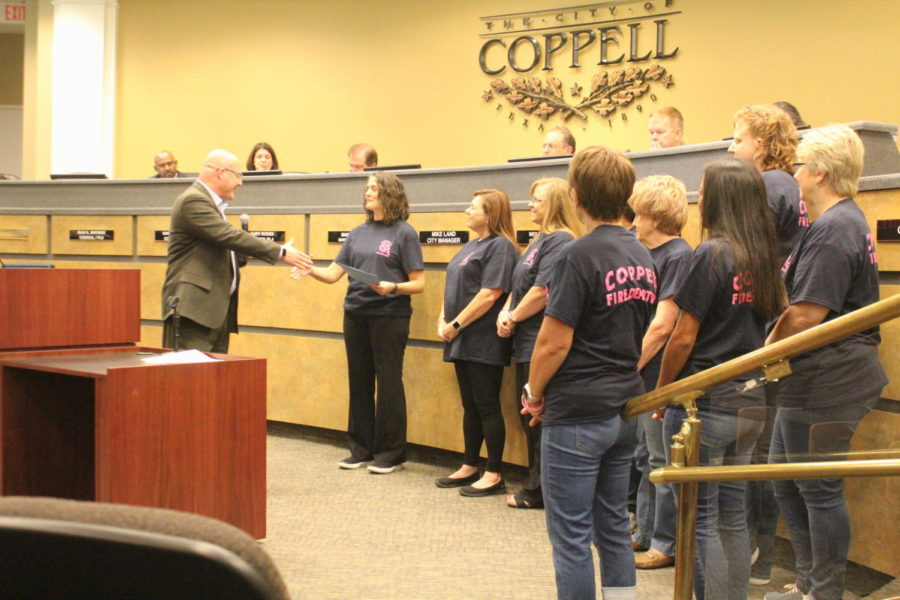 During Tuesday's Coppell City Council meeting at Coppell City Hall, council members proclaim October as Breast Cancer Awareness Month. Members of Pink Soles in Motion came forward to accept the proclamation as Mayor Pro Tem Mark Hill encouraged residents to be aware of early detection signs of breast cancer.