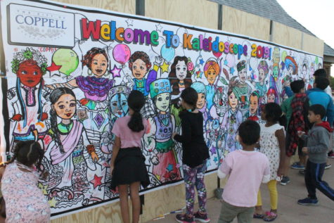 Attendees color on a mural which represents the various cultures in the Coppell community at Saturday's Kaleidoscope at Andy Brown Park East. Kaleidoscope was held on Saturday for the third year to promote cultural diversity in Coppell.