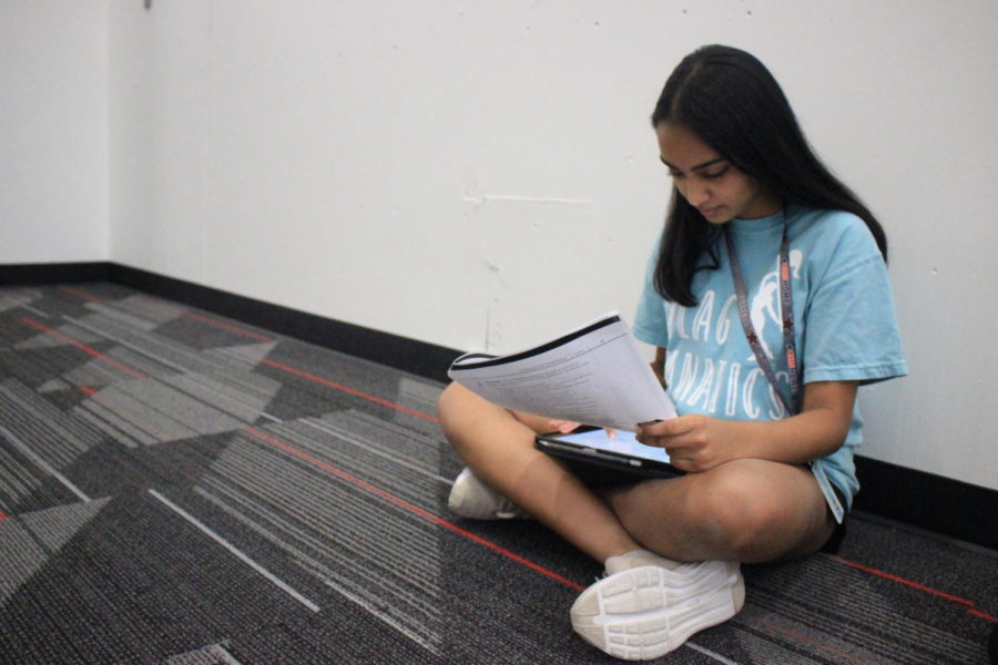 Coppell High School sophomore Aarushi Chitagi practices her Spanish during language teacher Michael Egan's second period AP Spanish IV class on Thursday. Chitagi practices speaking an article in Spanish for a grade.
