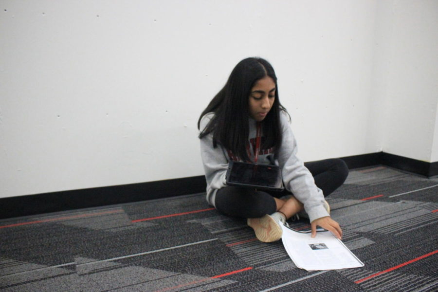 Coppell High School sophomore Shriya Chilukuri practices her Spanish during language teacher Michael Egan's second period AP Spanish IV class on Thursday. Chilukuri practices speaking an article in Spanish for a grade.