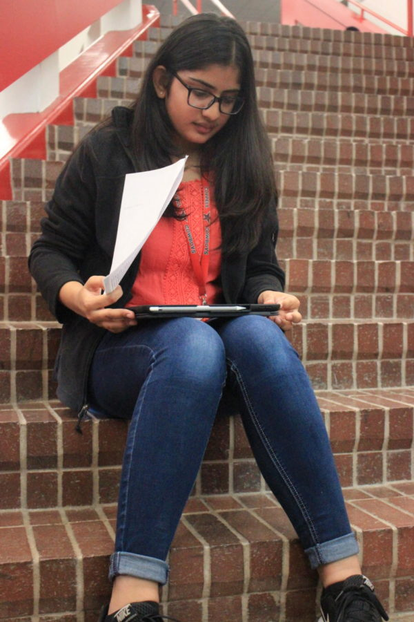 Coppell High School junior Mili Patel practices her Spanish during language teacher Michael Egan's second period AP Spanish IV class on Thursday. Patel practices speaking an article in Spanish for a grade.