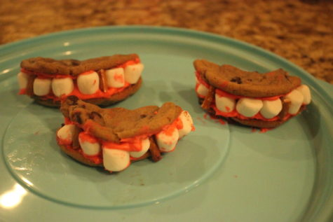 Spooky themed sweets are a delicious way to get into the Halloween spirit. These vampire teeth cookies are a great addition to any Halloween party or get-together.