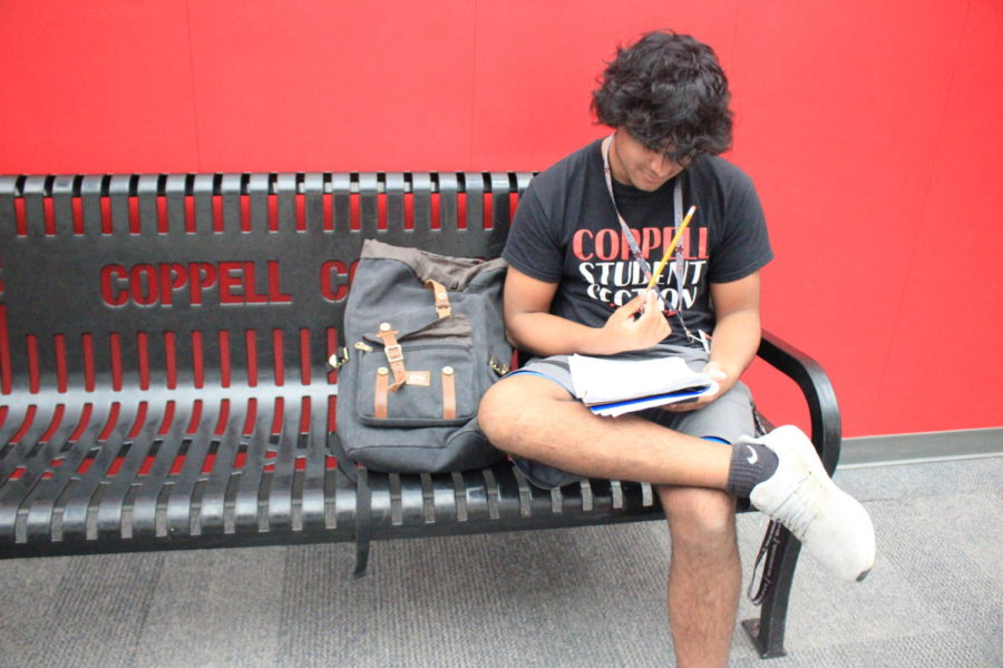 Coppell High School senior Manjul Raj practices his Spanish during language teacher Michael Egan's second period AP Spanish IV class on Thursday. Raj practices speaking an article in Spanish for a grade.