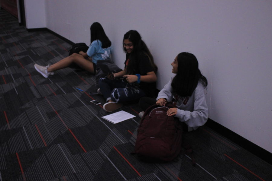 Coppell High School sophomores Aarushi Chitagi, Shriya Chilukuri and Shikha Golechha practice their Spanish during language teacher Michael Egan's second period AP Spanish IV class on Thursday. Chitagi, Chilukuri, and Golechha practice speaking an article in Spanish for a grade.
