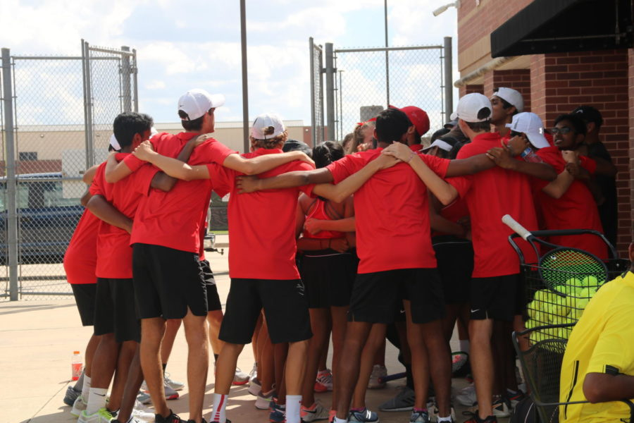 The+Coppell+High+School+tennis+team+huddles+before+its+match+at+the+CHS+Tennis+Center+on+Sept.+28.+The+Coppell+tennis+team+defeated+Longview%2C+17-2.%0A