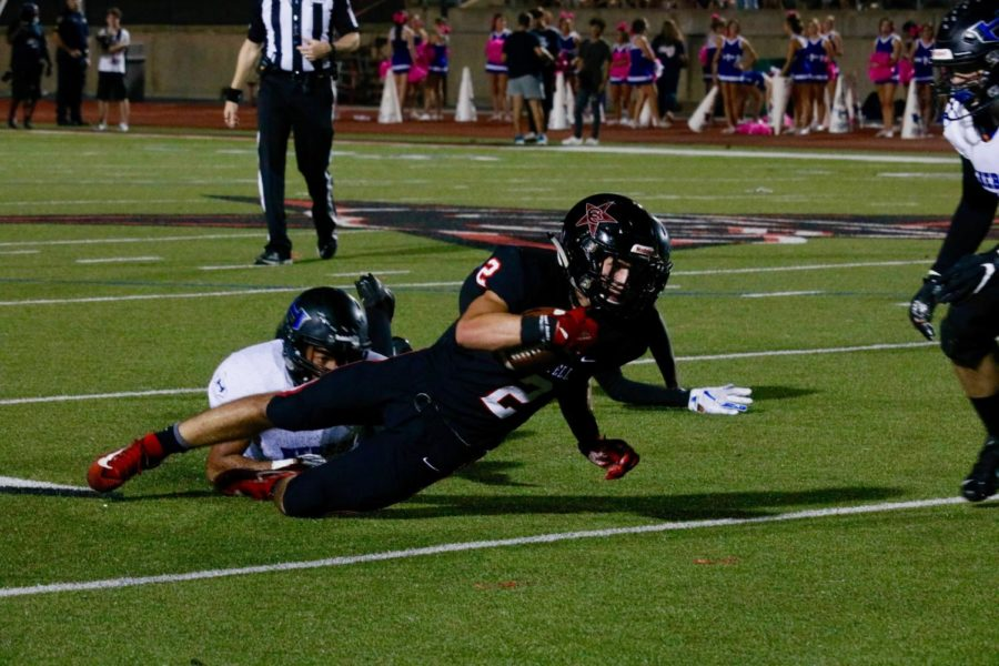 Coppell+senior+wide+receiver+Jan+Rivera+is+tackled+after+a+catch+in+the+red+zone.+The+Cowboys+fell+short+in+their+first+home+District+6-6A+game%2C+35-27%2C+against+Hebron+on+Friday+night+at+Buddy+Echols+Field.