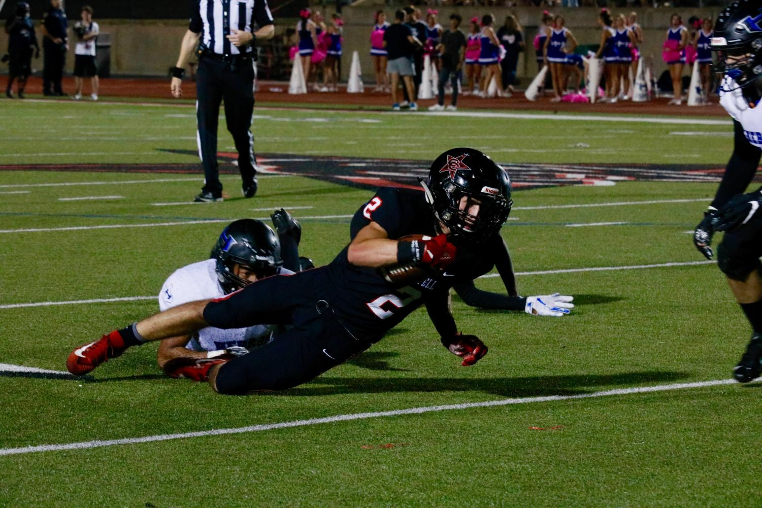 Coppell senior wide receiver Jan Rivera is tackled after a catch in the red zone. The Cowboys fell short in their first home District 6-6A game, 35-27, against Hebron on Friday night at Buddy Echols Field.
