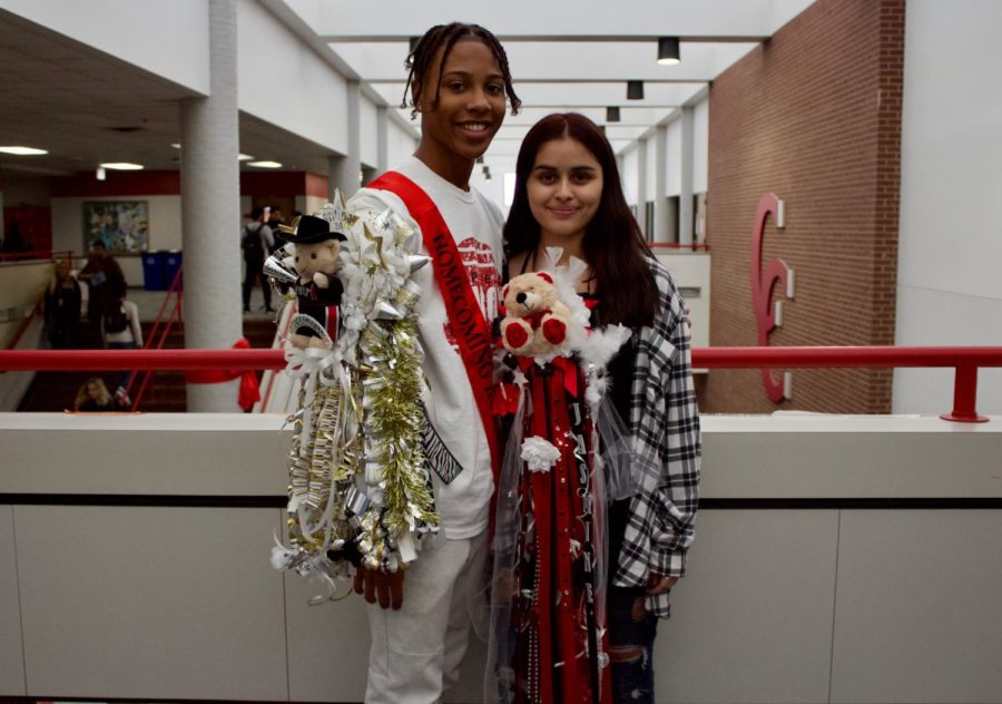 Coppell High School senior Zack Findley and sophomore Jasmine Gomez wear their homecoming mum and garter during passing period on Friday on the senior bridge. The homecoming dance will take place on Oct. 26 at the Irving Convention Center from 8 p.m. to 12 a.m.