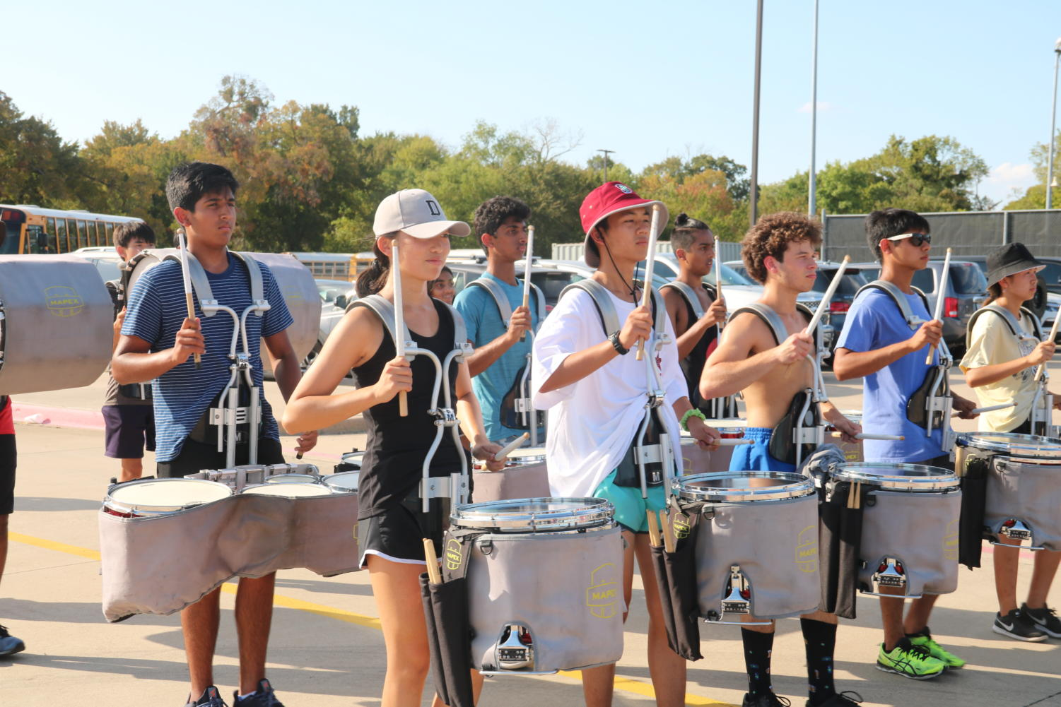 The Coppell Drumline marches after school on Sept. 26 in preparation for the Lewisville Drumline Invitational and Lone Star Classic competitions. The drumline won third place in the HEB Drumline Contest that took place Sept. 14.
