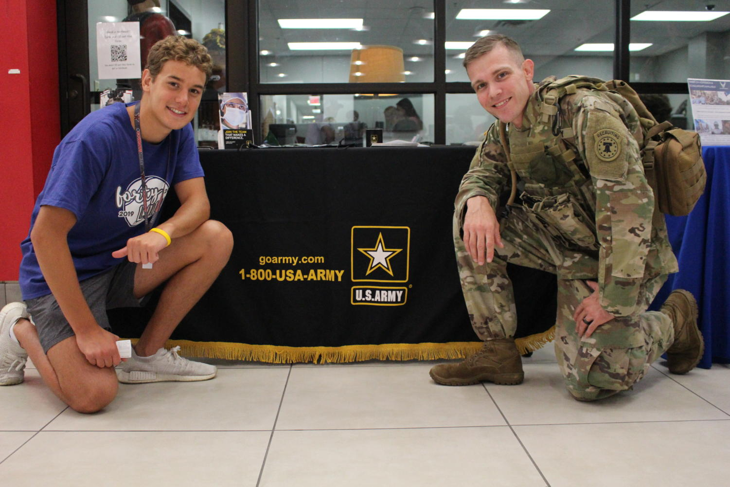 Coppell senior Johan Pretorius, pictured next to staff sergeant Michael Bell in the CHS Commons during a U.S. Army visit, verbally committed to West Point after an offer to join the Army's swim team. Pretorius has dedicated his time to swimming and has been previously featured in The Sidekick for his accomplishments in swimming.