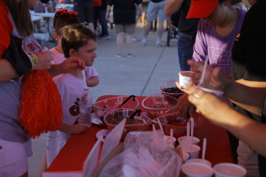 Coppell+junior+choir+member+Annellise+Holguin+scoops+ice+cream.+Coppell+ISD+hosted+its+home+game+tailgate+in+the+Buddy+Echols+Field+parking+lot+on+Friday+before+the+football+game+against+Hebron.%0A