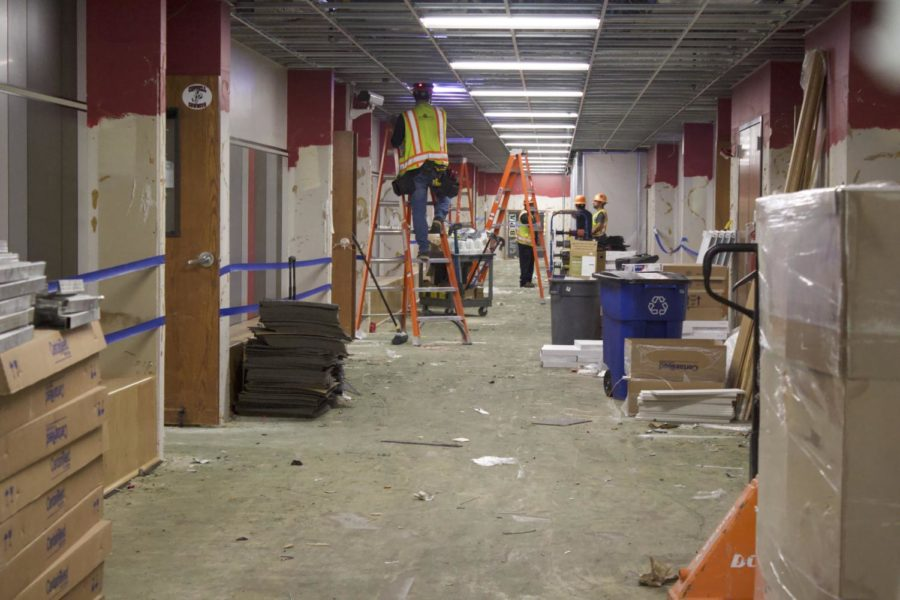 Construction workers renovate the upstairs C hall at Coppell High School on Wednesday at Coppell High School. The campus renovations started in June and the building is scheduled to be completed in August.