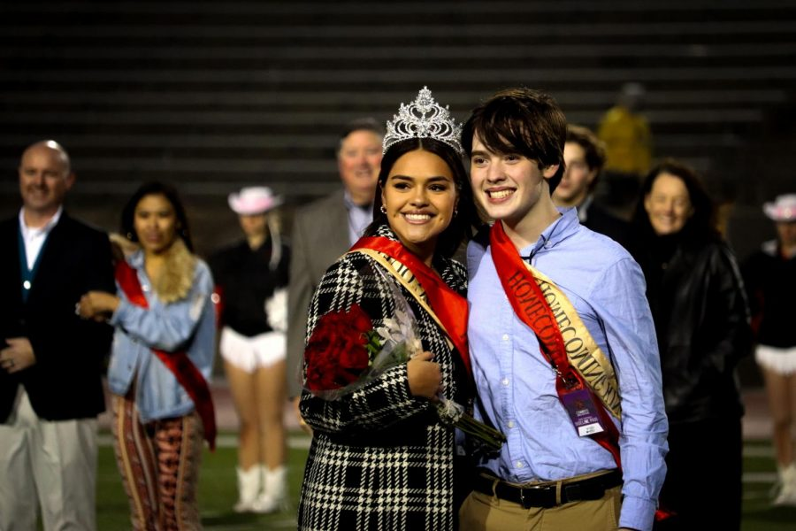Coppell seniors Alex McCord and Ana Hinojos wave at the crowd after being crowned homecoming king and queen on Friday night before the game against Irving Nimitz at Buddy Echols Field. The Cowboys beat the Tigers 55-7 in their fifth district game of the season, bringing their district record to 2-3.