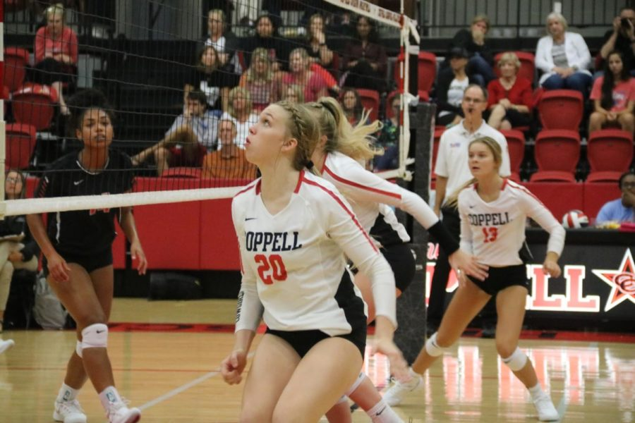 Coppell freshman outside hitter Reagan Engler prepares to block against Arlington Martin on Aug. 27 in the CHS Arena. The Cowgirls face Lewisville tomorrow at 6:30 p.m. in the CHS Arena.