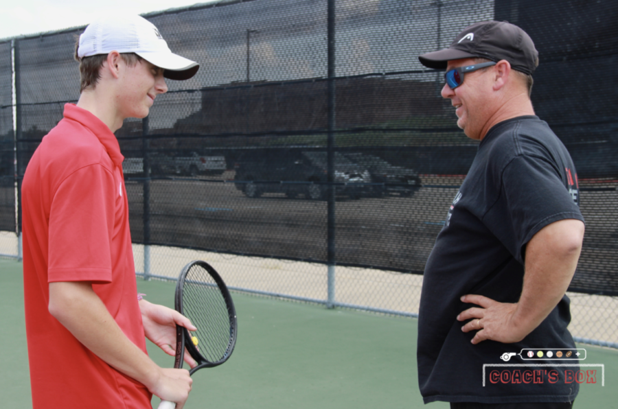 Coppell coach Rich Foster instructs senior team captain Clark Parlier during tennis practice at the CHS Tennis Center during eighth period. Foster coaches before and after school while striving to lead his players to success.