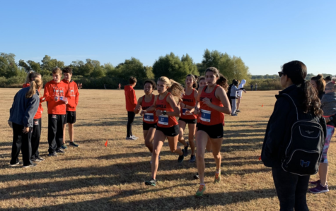 Coppell junior Natalie Fleming, senior Shelby Spoor and junior Chloe Hassman run in the District 6-6A Championship meet on Friday. CHS varsity boys finished second and CHS varsity girls finished first, allowing both teams to advance to the Class 6A Region I Meet.