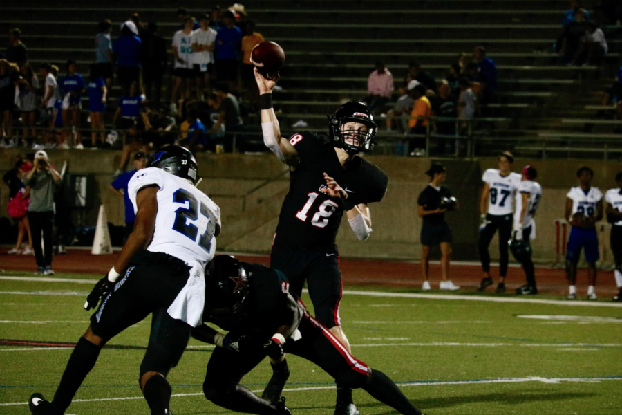 Coppell+junior+quarterback+Ryan+Walker+throws+a+pass+during+the+home+district+opener+against+Hebron+on+Oct.+4.+Walker+plays+two+offensive+positions+and+leads+the+team+in+a+pregame+speech+and+prayer.