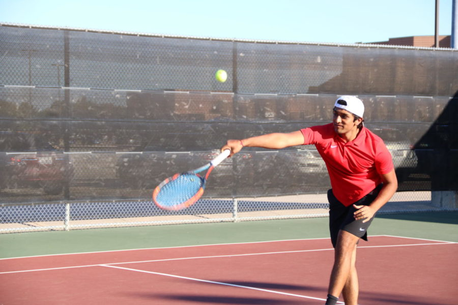 Coppell High School senior Devan Patel approaches the net to volley against Irving Nimitz at the CHS Tennis Center on Oct. 8 during Senior Night. Coppell defeated Nimitz, 19-0.