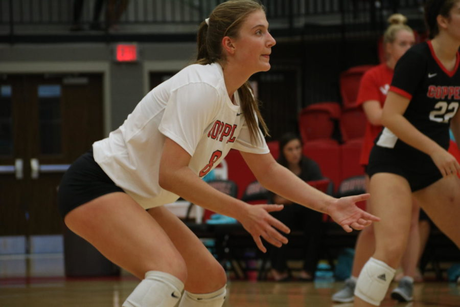 Coppell junior outside hitter Haley Holz awaits a serve during the match against Marcus in the CHS Arena on Sept. 24. Holz is one of many high school athletes playing both sand and indoor volleyball.