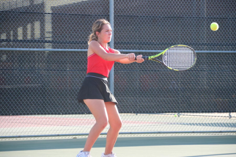 Coppell senior Reagon Stone forehands during the tennis team's Class 6A bi-district match at the Coppell High School Tennis Center on Tuesday. Coppell defeated Denton Guyer, 10-2.