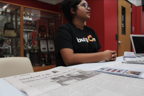 Senior buildOn co-founder Ananya Pagadala displays the article written about buildOn in the October issue of The Sidekick on her table at the club expo during C lunch on Friday. Coppell High School students were given the opportunity to promote their clubs to students to gain membership for the school year at the expo on Friday.