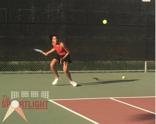 Coppell High School junior and JV 1 tennis player Sonia Bhattacharyya returns a serve at the Coppell vs. Flower Mound match on Oct. 3. Bhattacharyya has four years of experience playing tennis and plans to continue for the remainder of high school.