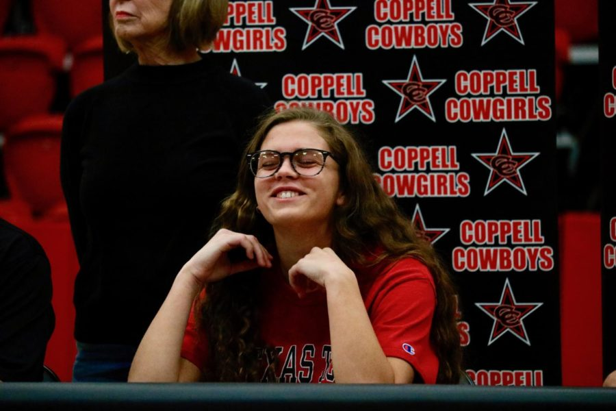 Prior+to+officially+signing+to+play+soccer+at+Texas+Tech+University%2C+Coppell+senior+defender+Katie+Odum+smiles+at+the+crowd+in+the+CHS+Arena.+Wednesday+was+National+Signing+Day%2C+the+first+day+a+high+school+senior+can+sign+a+National+Letter+of+Intent.