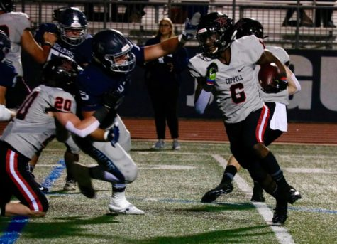 Coppell junior running back Jason Ngwu slips past Flower Mound defenders at Neal E. Wilson Stadium on Nov. 1. The Cowboys face Irving Nimitz tomorrow at 7 p.m. at Buddy Echols Field for their last game of the season.