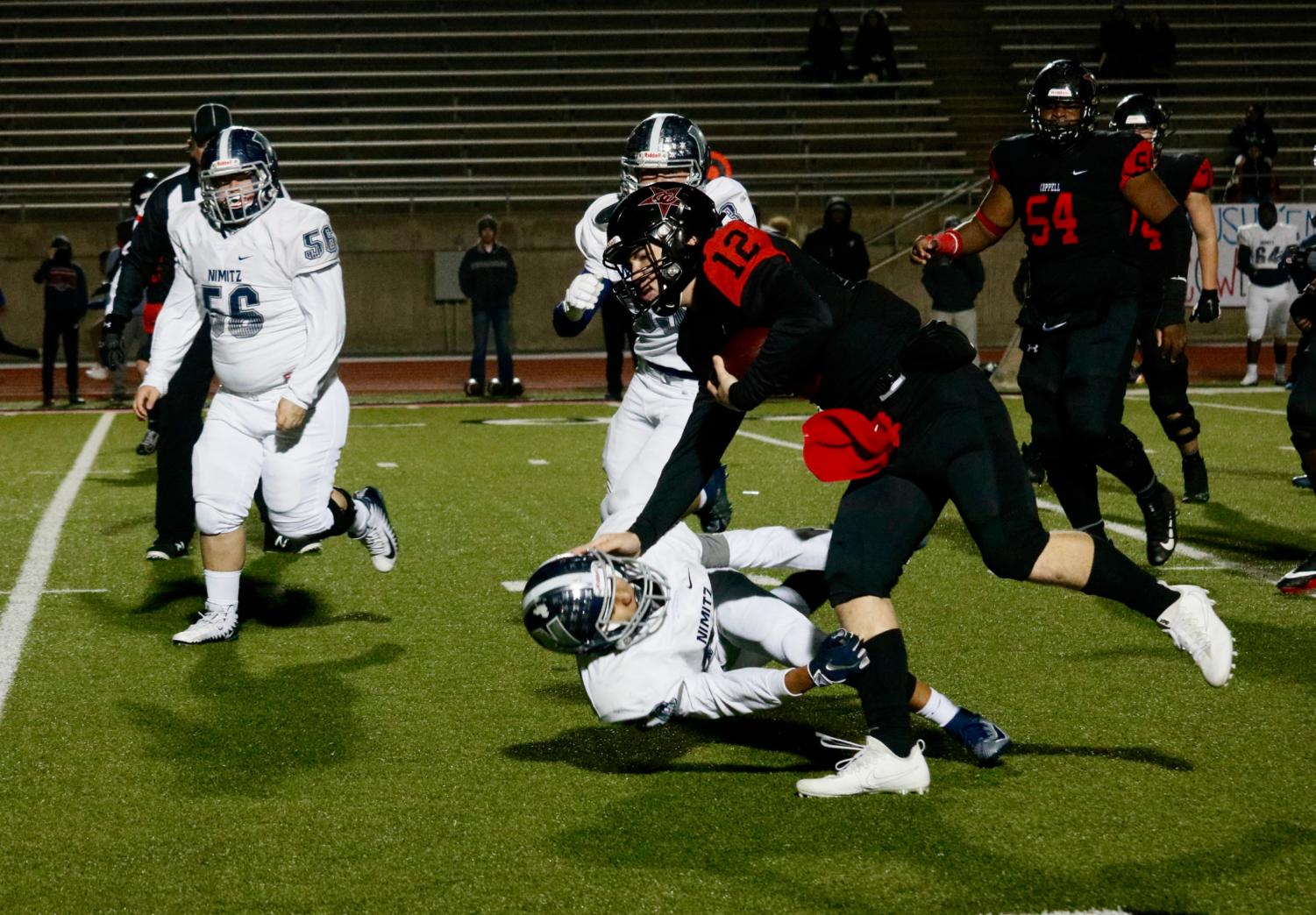 Coppell senior quarterback Kevin Shuman scores the last touchdown of the season with 8:42 remaining in the fourth quarter. Coppell defeated Irving Nimitz, 49-13, in the season finale on Friday night at Buddy Echols Field.