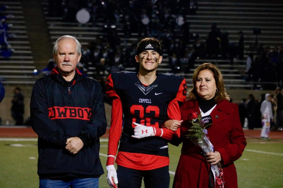 Coppell+senior+wide+receiver+and+trumpet+player+Nathan+Kinley+gets+recognized+for+his+final+year+in+the+band+program+with+his+parents.+He+pursues+both+the+sport+and+the+instrument+with+equal+passion.