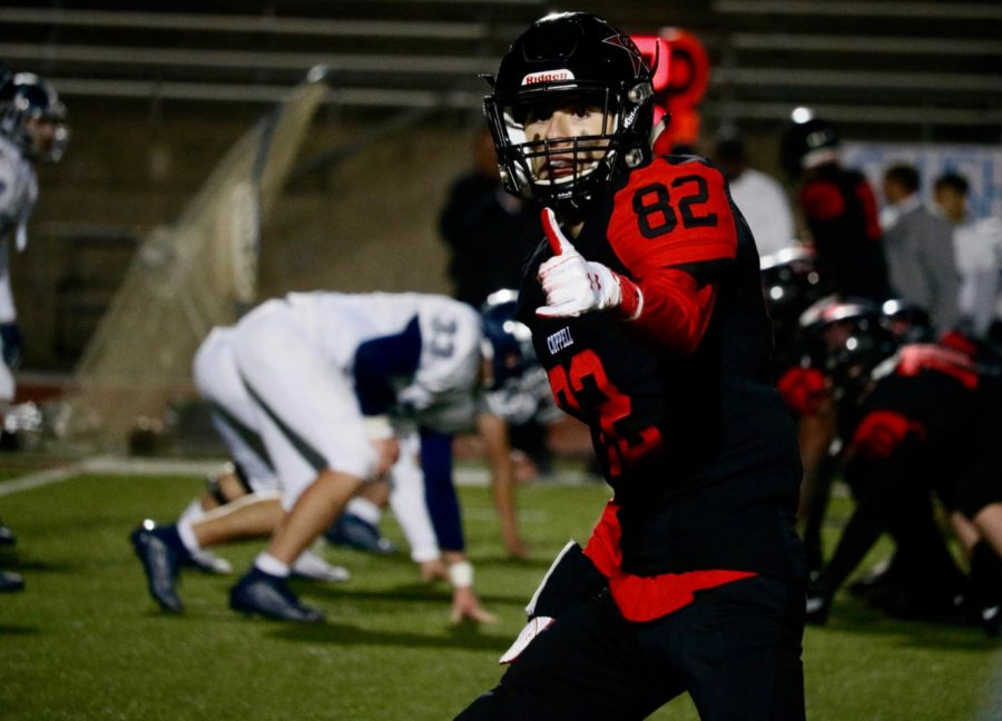 Coppell+senior+wide+receiver+Nathan+Kinley+lines+up+with+the+referee+at+the+beginning+of+a+play+on+Friday+against+Irving+Nimitz+at+Buddy+Echols+Field.+Kinley+balances+the+sport+with+his+other+passion+for+playing+the+trumpet.