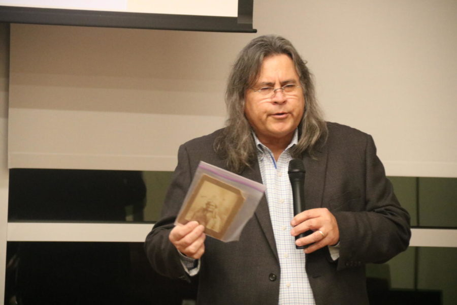 Lance Tahmahkera speaks about the lives of members of the Comanche tribe from over a century ago in a set of old photos that he has preserved on Thursday. Tahmahkera travels around the country telling the stories of his tribe to keep people aware of his tribes lives and their legends.