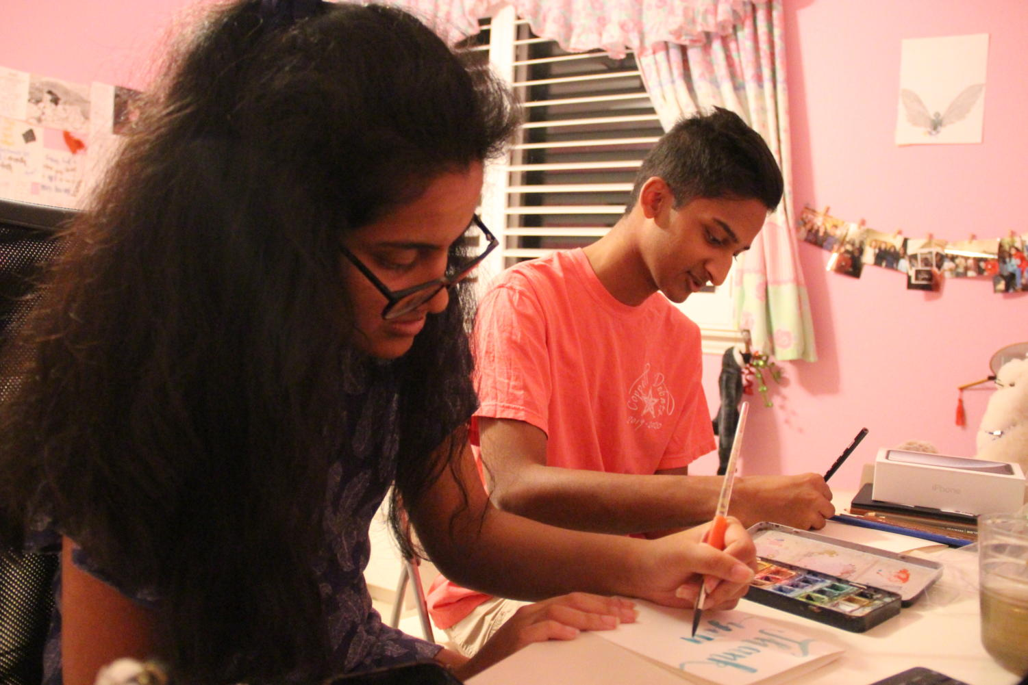CHS9 student Maya Palavali and CHS sophomore Rohan Palavali create holiday cards at their house on Nov. 10. The Palavali siblings founded a non-profit called Pal O Valley Cards, where all profits from the sale of their custom-made greeting cards are donated to the charity Doctors Without Borders.